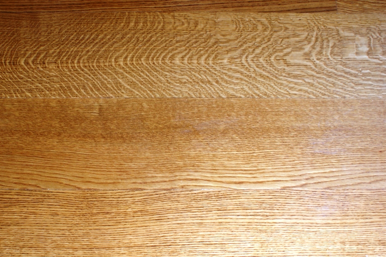 Close up view of the grain of quarter/rift sawn White Oak flooring.