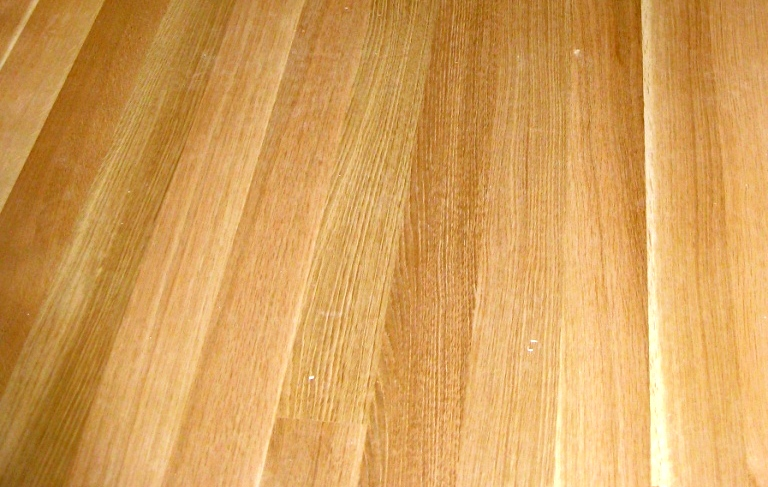 Close-up view of the grain of rift sawn White Oak wood flooring.