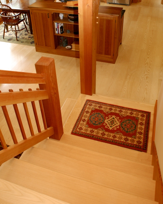 Clear grained pale wood Ash floors contrast nicely with the warm hues of Douglas Fir timbers and trim.