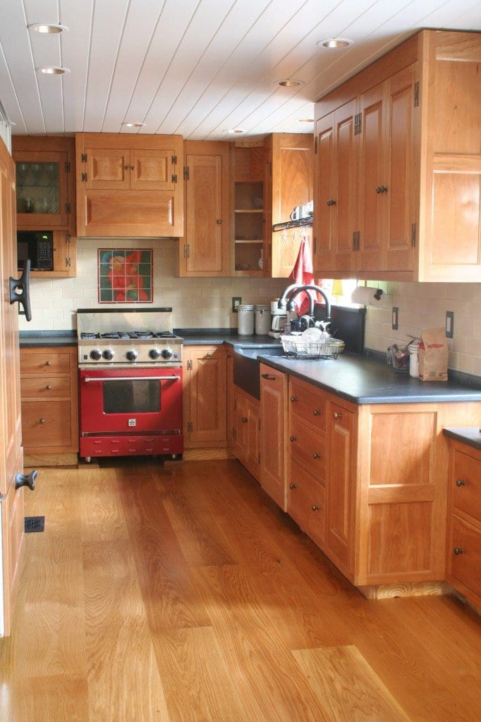 White Oak floors same tone as the wood in the cabinets of this kitchen.
