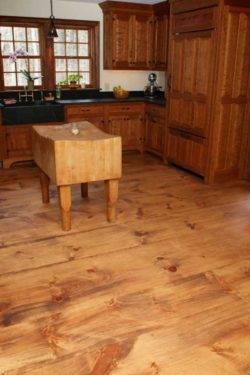 Figure 2: The homeowners chose wide plank pine flooring for their kitchen (Hull floor #418) for a period look and utilized an oil finish that would be easy to touch up and repair.