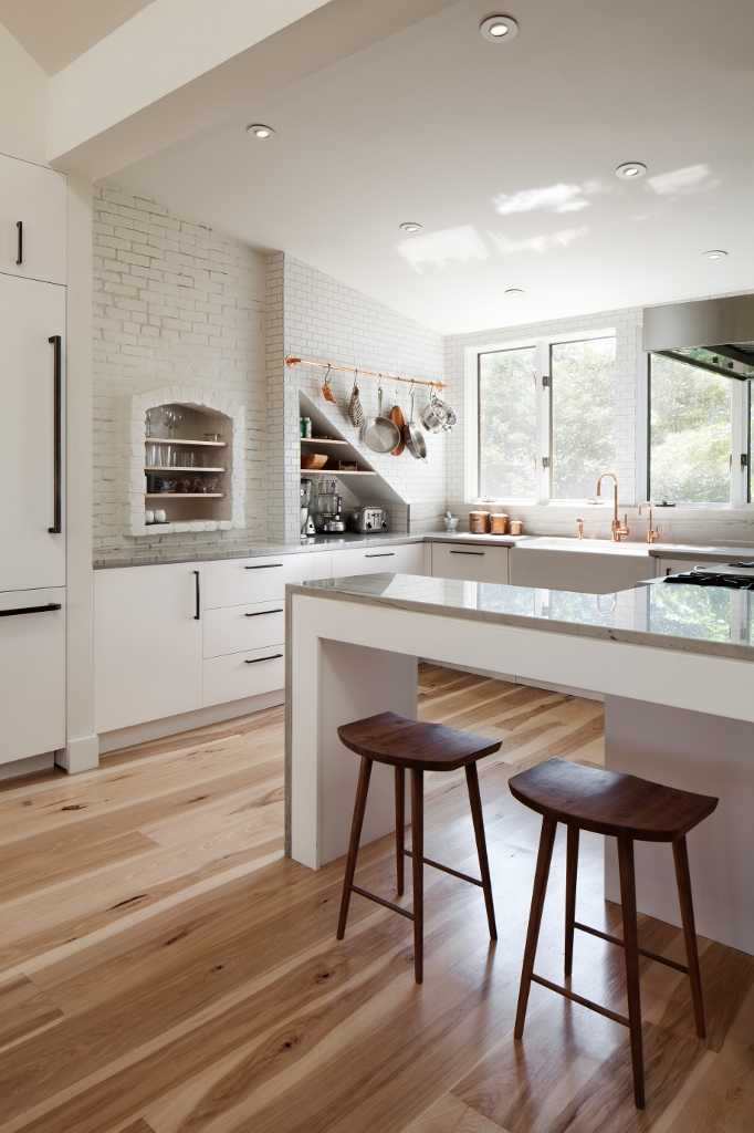 White kitchens with warm wood tone wood floors for Beautiful modern white kitchens